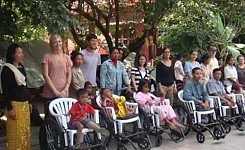 Volunteers_with_wheelchair_recipients_in_cambodia
